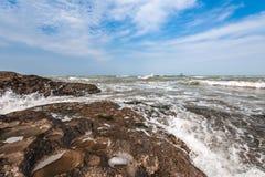 Splash of waves on a rocky seashore. Landscape stock photography