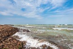 Splash of waves on a rocky seashore. Landscape royalty free stock images