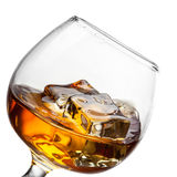 Splash of whiskey in glass isolated on white Stock Images