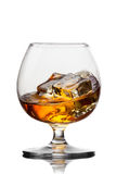 Splash of whiskey with ice in glass isolated Royalty Free Stock Photography