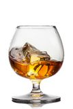 Splash of whiskey with ice in glass isolated Stock Photo