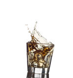Splash of whiskey with ice osolated on white Stock Photos