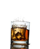 Splash of whiskey with ice osolated on white Royalty Free Stock Images