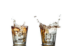 Splash of whiskey with ice osolated on white Stock Image