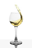 Splash of white wine in the cup filling Stock Photo