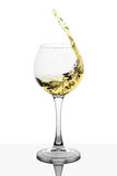Splash of white wine in the cup filling Royalty Free Stock Images