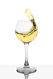 Splash of white wine in the cup filling Royalty Free Stock Image