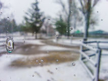 Splash on window in frost season Stock Photo