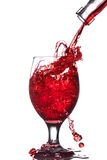 Splash of wine in the cup filling Royalty Free Stock Photos