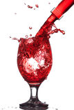 Splash of wine in the cup filling Royalty Free Stock Photo