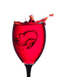 Splash of wine in the cup filling Stock Image