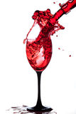 Splash of wine in the cup filling Royalty Free Stock Image