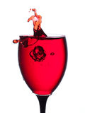 Splash of wine in the cup filling Royalty Free Stock Images