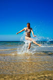 Splash. Young Woman Enjoying in water. Summertime Royalty Free Stock Images