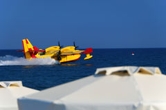 Splashdown (water landing) seaplane. Splashdown (water landing) on the sea seaplane tourist summer resort stock photos