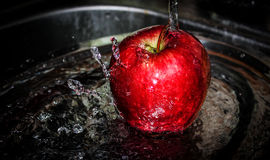 Splashed apple Royalty Free Stock Photos