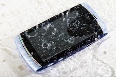 Splashed cellphone. Picture of cellphone under shower Royalty Free Stock Photo