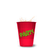 Splashed drink in party cup Royalty Free Stock Image