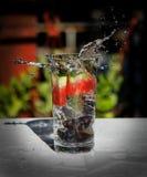 Splashed fruit infused water Stock Photo
