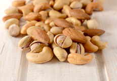 Splashed nuts mix Stock Images