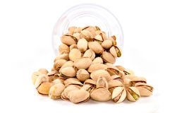 Splashed pistachios Stock Images