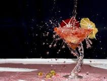 Splashed red martini Stock Images