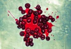 Splashed sour cherries on metallic surface sour cherry fruits Stock Photos