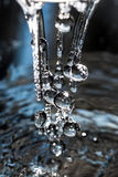 Splashed water drops. Fresh, blue water. Royalty Free Stock Photography