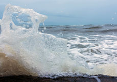 Splashes of aqua blue, frozen, close up. Splashes of water from the sea waves big frozen Royalty Free Stock Photo