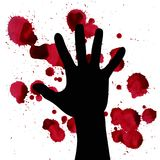 Splashes of blood and hand black silhouette. may illustrate the theme of violence, terrorism and war. Splashes of blood and hand black silhouette. may Stock Images