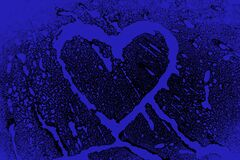 Splashes of blue color forming heart