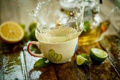 Splashes of citrus beverage with lemon Royalty Free Stock Images