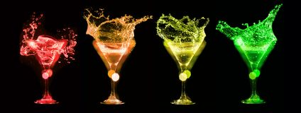 Splashes of cocktails in glasses Stock Photography