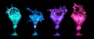 Splashes of cocktails in glasses Stock Image
