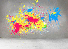Splashes of color on grey wall Stock Image