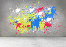 Splashes of color on grey wall Stock Images
