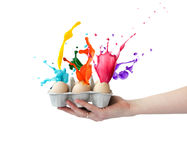 Splashes of colored paint from Easter eggs Stock Photography