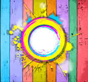 Splashes on a colorful grunge striped wooden backgrou Stock Photos