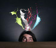 Splashes of colorful ink and man Royalty Free Stock Photos