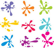 Splashes of colorful ink on white Royalty Free Stock Images