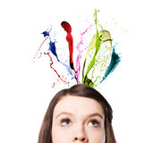 Splashes of colorful ink and woman Stock Photography