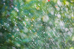 Splashes and drop on a natural background stock images
