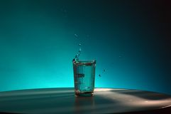 Splashes and drops of water in faceted glass. Riple Royalty Free Stock Images