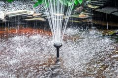 Splashes, drops of water in fountain Royalty Free Stock Images