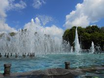 Splashes of fountain in the park. Stock Photos