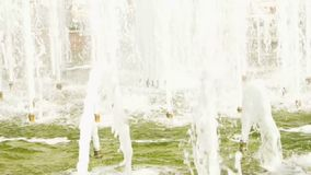 Splashes of fountain water in a sunny day stock video footage