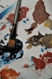 Splashes of paint with a paintbrush. On a white background royalty free stock photo