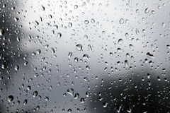 Splashes of rain. Drops of water remaining in the glass after the last rain Stock Images