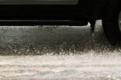 Splashes in rainy day Royalty Free Stock Photo