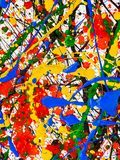 Splashes on red and black and green and yellow and blue paint. An abstraction with splashes of black and red and green and yellow and blue paint on a white royalty free stock images